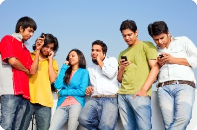Six Young Indian Friends People Talking on cell phones SMS